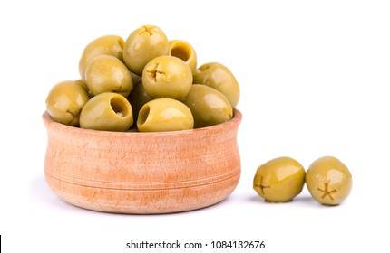 Pitted and marinated green olives in wooden bowl, isolated on white background.