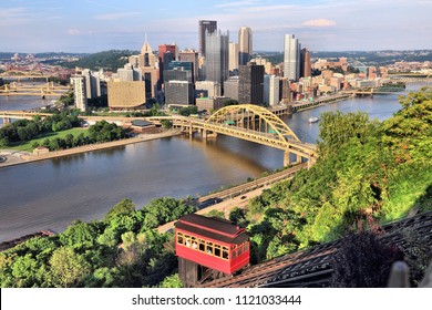 Pittsburgh city skyline with Duquesne Incline funicular. Sunset light.