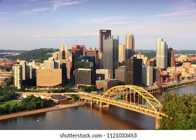 Pittsburgh city skyline in sunset light. Monongahela River.