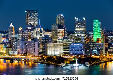 "Pittsburgh downtown skyline by night. Located at the confluence of the Allegheny, Monongahela and Ohio rivers, Pittsburgh is also known as ""Steel City"", for its more than 300 steel-related businesses"