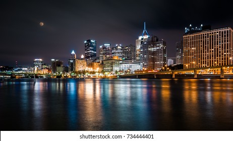 Pittsburgh downtown skyline by night viewed from North Shore Riverfront Park across Allegheny River.