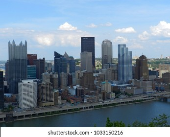 PITTSBURGH, PA -APRIL 30, 2017: City downtown on a spring day seen from Mount Washington overlook. Landscape of city seen over Monongahela river at Pittsburgh, PA on April 30, 2017