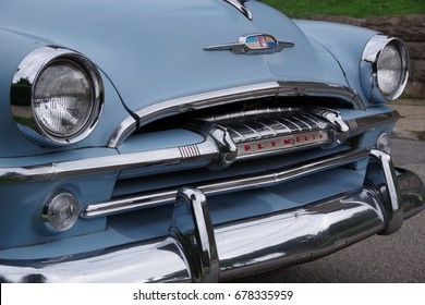 PITTSBURGH, PA -JULY 10, 2017: Plymouth Belvedere Hy-Drive 1954. Front right closeup of chrome plated parts at Pittsburgh, PA on July 10, 2017