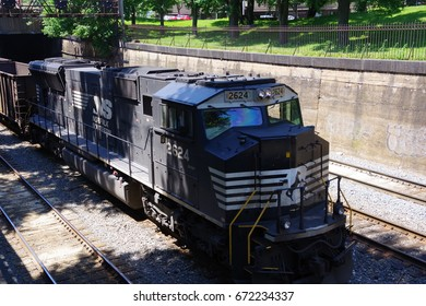 PITTSBURGH, PA- JUNE 3, 2017: Norfolk Southern train passing through North Side Park.Front view of locomotive at Pittsburgh, PA on June 3, 2017