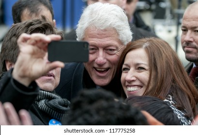 PITTSBURGH, PA - NOVEMBER 5:  Former President Bill Clinton poses with attendees of a rally while campaigning for Barack Obama in Pittsburgh, PA on November 5, 2012.