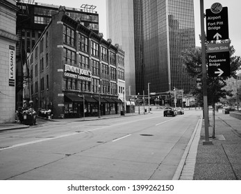 Pittsburgh, PA. / USA - 04/28/2019: Downtown Pittsburgh restaurants and historic buildings along Liberty and Forbes Avenue.