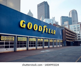 Pittsburgh, PA. / USA - 05/19/2019: Goodyear tire shop downtown with Pittsburgh skyline in the background