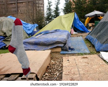 Pittsburgh, PA USA. December 18, 2011. Sock drying on a stick in a tent camp in downtown Pittsburgh Pennsylvania.