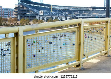 PITTSBURGH, PA / USA - NOVEMBER 7, 2018: Love locks attached to a fence on the Roberto Clemente Bridge don't have long to stay according to city officials, as bridge renovations are scheduled soon.