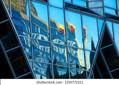PITTSBURGH, PA / USA - NOVEMBER 7, 2018: Abstract reflections in glass of the JLL Center in PPG Place at the end of a sunny fall day in downtown.