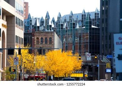 PITTSBURGH, PA / USA - NOVEMBER 7, 2018: Glass turrets mark a building in PPG Plaza in downtown, with fall foliage along the street.