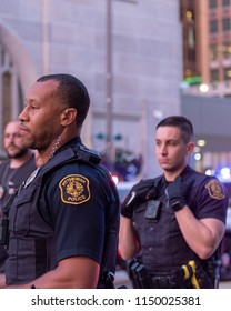 Pittsburgh, PA/USA - July 25, 2018 Police officers stand ready during a protest in the streets pf Pittsburgh. Officer Michael Rosfeld is charged with Criminal Homicide in the shooting of Antwon Rose.