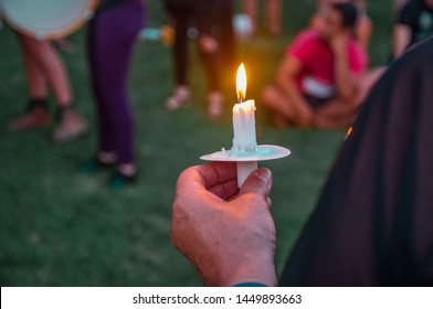 Pittsburgh, Pennsylvania / United States - 7-12-19: A man holds his candle at the Lights for Liberty vigil