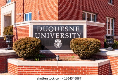Pittsburgh, Pennsylvania, USA 3/1/20 The Duquesne University sign on campus on a sunny winter day