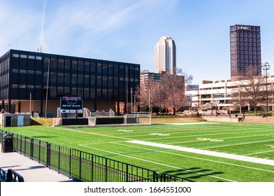 Pittsburgh, Pennsylvania, USA 3/1/20 Rooney Athletic Field at Duquesne University with Mellon Hall and downtown Pittsburgh in the background