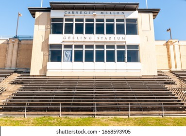 Pittsburgh, Pennsylvania, USA 3/8/20 The press box at Gesling Stadium with bleachers beneath it on the campus of Carnegie Mellon University overlooking the football field