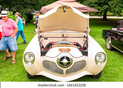 Pittsburgh, Pennsylvania, USA 7/20/2019 The Pittsburgh Vintage Gran Prix in Schenley Park, a yearly event since 1983 featuring car shows and circuit races. A white Studebaker with it's hood open