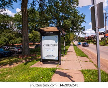 Pittsburgh, Pennsylvania, USA 7/25/2019 An Allegheny County Port Authority bus shelter on south Braddock Avenue in the city's east end on a summer day