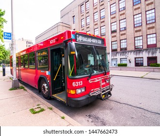 Pittsburgh, Pennsylvania, USA 7/6/2019 A Allegheny County Port Authority bus parked outside of a building on a layover