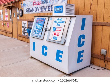 Pittsburgh, Pennsylvania, USA 9/8/2019 A two door ice container that holds bags of ice for sale outside of a beer distributor in summer time