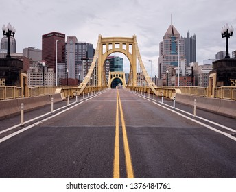 Pittsburgh, Pennsylvania / USA -  April 21,2019: View of the Pittsburgh skyline over the Roberto Clemente Bridge near PNC park