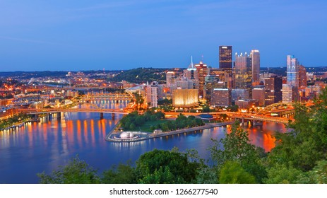 Pittsburgh, Pennsylvania, USA - May 20, 2018: Pittsburgh Skyline Showing Downtown  After Sunset Viewing From Grandview Overlook, Pittsburgh, USA.