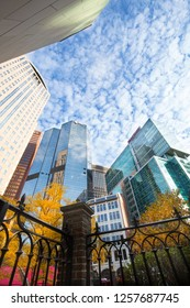 Pittsburgh, Pennsylvania / USA - November 7, 2018: Towering skyscrapers in downtown Pittsburgh, Pennsylvania in autumn, against a blue sky with puffy white clouds.