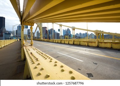 Pittsburgh, Pennsylvania / USA - November 7, 2018: Dramatic view of the downtown skyline and the topside of the Rachel Carson Bridge over the Allegheny River.
