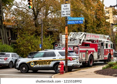 Pittsburgh, Pennsylvania / USA – Oct 27 2018: Police and firefighters secure the area surrounding Tree of Life synagogue in Pittsburgh, the scene of Saturday morning's mass shooting.