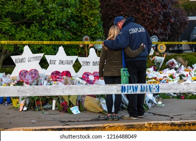 Pittsburgh, Pennsylvania / USA – Oct 30 2018: Chaplain Bob Ossler of Cape Coral FL comforts members of the community outside of the Tree of Life synagogue in Pittsburgh.