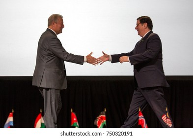 PITTSBURGH, PENNSYLVANIA, USA - OCTOBER 17 2017: Former US Vice President Al Gore and Mayor Bill Peduto of Pittsburgh shake hands on stage.