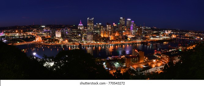 PITTSBURGH, PENNSYLVANIA-OCTOBER 19, 2017: NIGHTIME PANORAMIC PHOTOGRAPH SKYLINE OF PITTSBURGH, PENNSYLVANIA