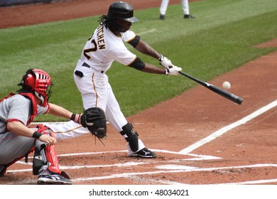 PITTSBURGH - SEPTEMBER 24 : Andrew McCutchen of the Pittsburgh Pirates swings and connects on a pitch against  Cincinnati Reds on September 24, 2009 in Pittsburgh, Pa.