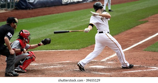 PITTSBURGH - SEPTEMBER 24 : Neil Walker of the Pittsburgh Pirates swings at a pitch against Cincinnati Reds on September 24, 2009 in Pittsburgh, PA.