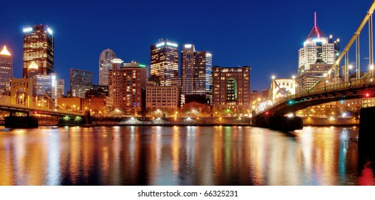 Pittsburgh Skyline at Night:  A view of Pittsburgh, Pennsylvania's cityscape at night overlooking the Allegheny River with views of the Roberto Clemente Bridge and Andy Warhol Bridge.