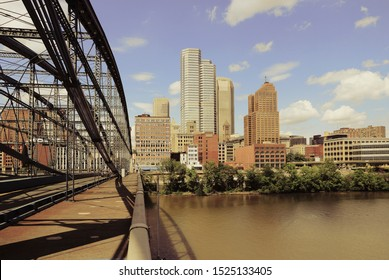 Pittsburgh skyline seen from Smithfield Street Bridge with Monongahela River. Retro filtered colors style.