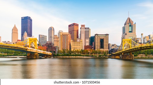 pittsburgh,pennsylvania,usa : 8-21-17. pittsburgh skyline at sunset with reflection in the water.