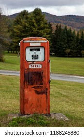 PITTSFIELD, VT, USA-OCTOBER 10, 2015: Old style Shell gasoline pump in Pittsfield near Vermont scenic road VT-100 with foliage color and blue sky.
