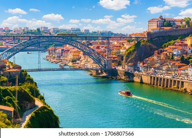 Pituresque, colorful view at old town Porto, Portugal with bridge Ponte Dom Luis over Douro river.
