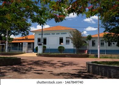 PIUMHI, MINAS GERAIS / BRAZIL - NOVEMBER 16, 2017: The facade and entrance of Escola Estadual Professor Jose Vicente public school saw from the Rua Bossuet Costa street in downtown Piumhi.
