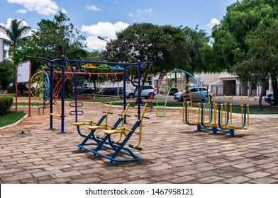 PIUMHI, MINAS GERAIS / BRAZIL - NOVEMBER 16, 2017: Public outdoor gym equipment in the middle of Praca Doutor Avelino Queiroz square installed by local authorities for use by locals in downtown Piumhi