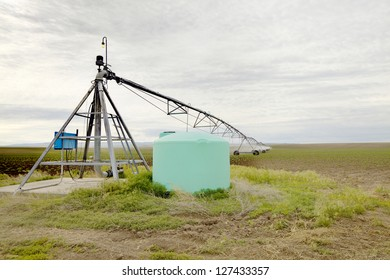 The pivot point of a farm sprinkler with a fertilizer tank