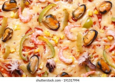 Pizza ai frutti di mare with octopus, mussels and shrimp texture macro. horizontal