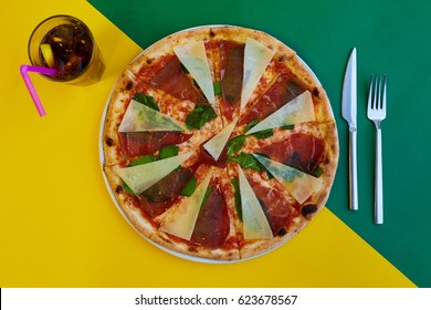 Pizza with bacon on top view with coke