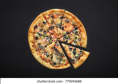 pizza barbecue with cornichoni olives peperoni cheese mozzarella on black stone background