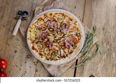 Pizza BBQ Chicken on a wooden background
