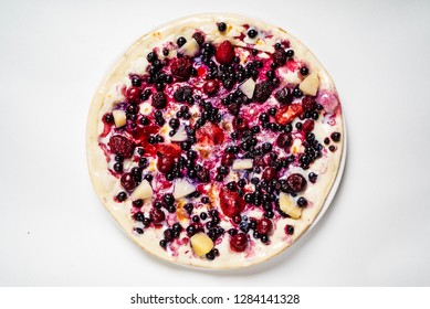 pizza with berries and fruits on the white background