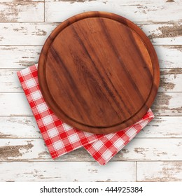 Pizza board with a napkin on wooden table. Top view mock up