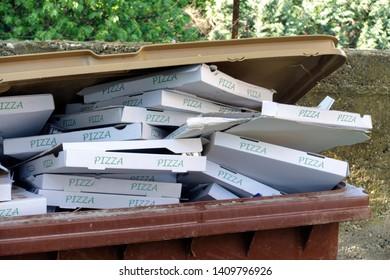 Pizza boxes in rubbish bin