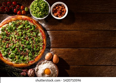 Pizza Broccoli and bacon on wood background. Top view, close up. Traditional Brazilian Pizza